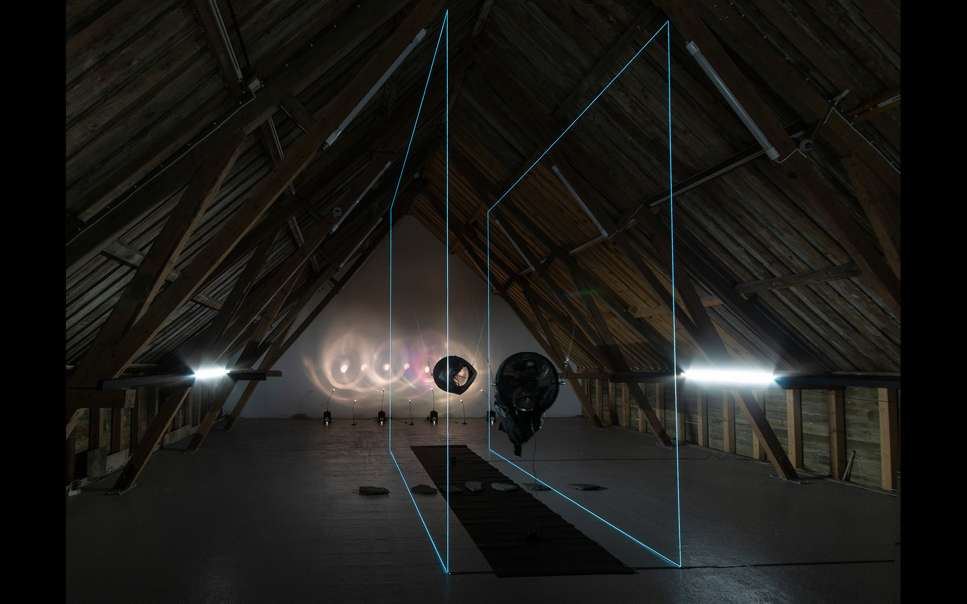 """Blow reBlow"", interactive wind installation. Light and sound installation ""Four Glasses"" in the back"